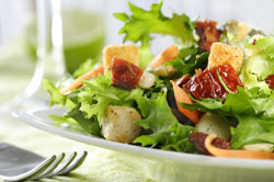 Salad Greens with Pumpernickel Croutons, Shaved Parmesan and Pumpkin Seed Oil Vinaigrette