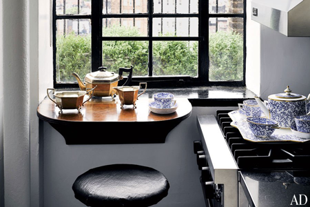 A tea service that once belonged to Queen Victoria rests on the kitchen's Viking range.